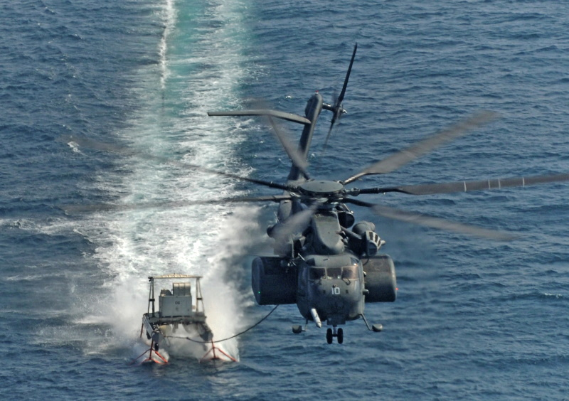 Sikorsky MH-53E towing minesweeper sled